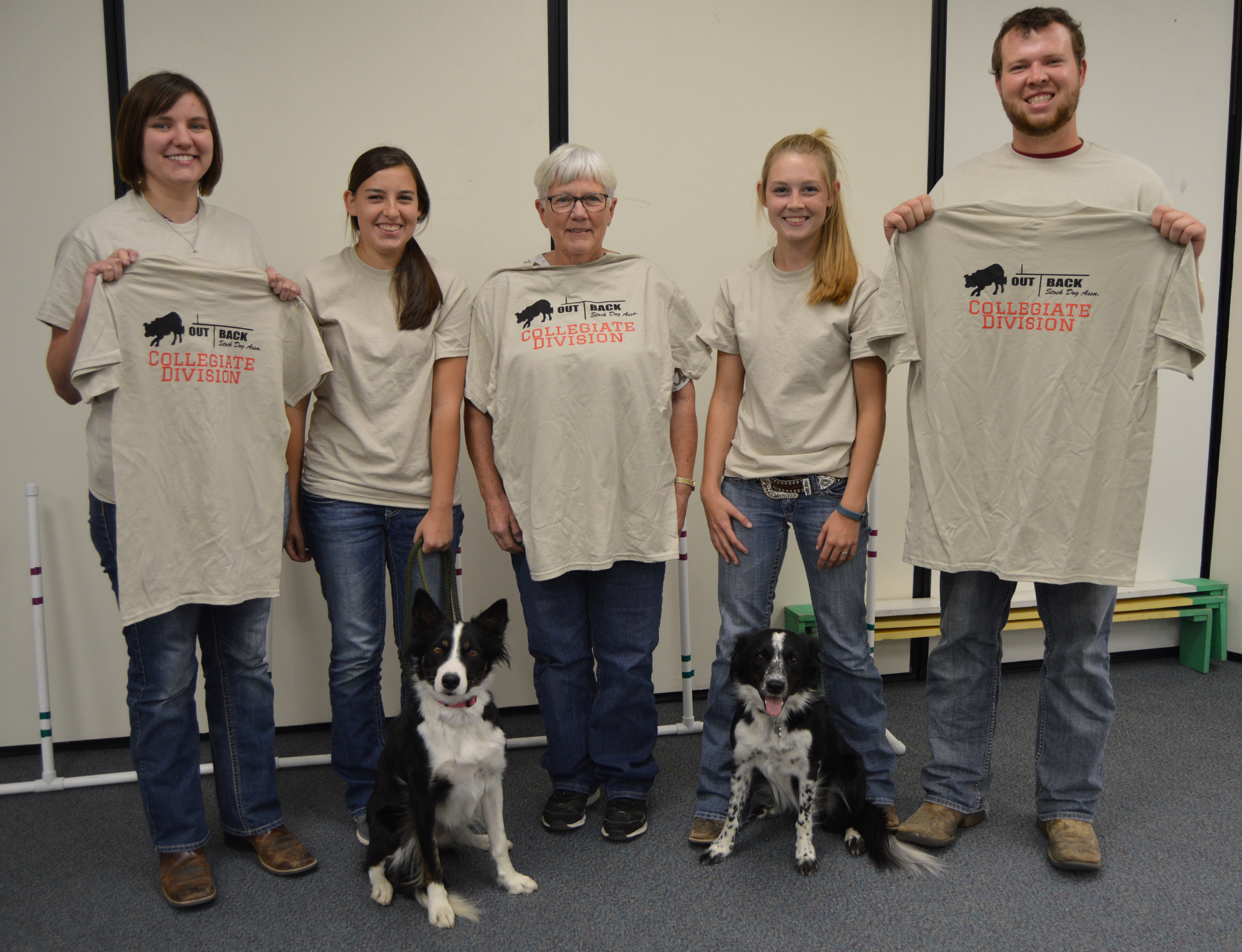 NCTA's first stock dog club unveils t-shirts in winter of 2016. Judy Bowmaster-Cole, center, is club advisor.