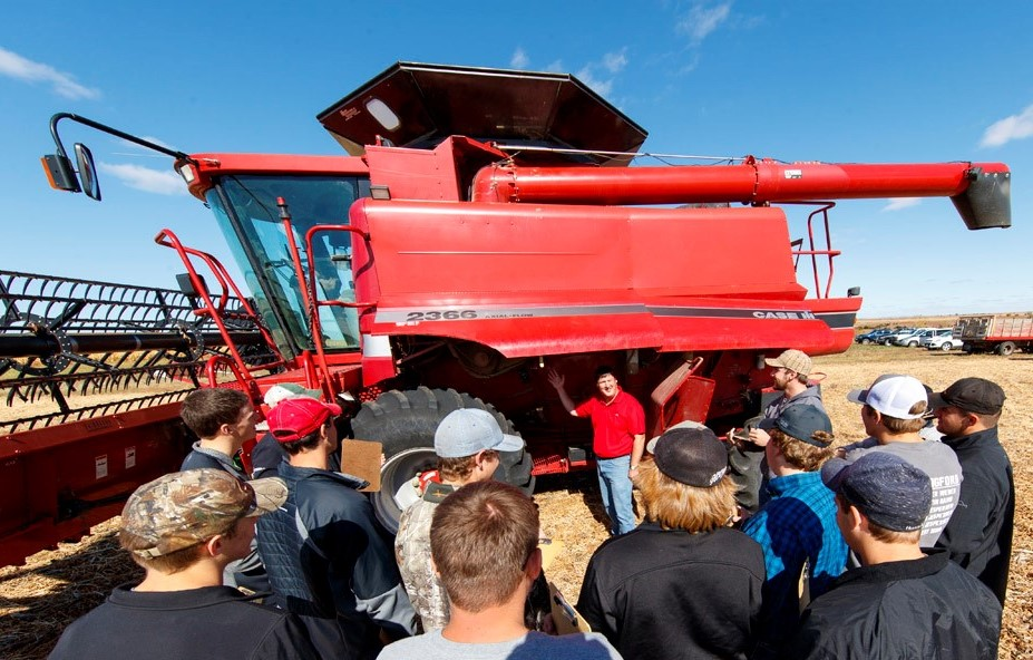 Brad Ramsdale, agronomy professor, discusses harvest operations with an agronomy class at the NCTA farm laboratory. Students can now earn an NCTA Agriculture Certificate with online courses. (Craig Chandler / NCTA News Photo)