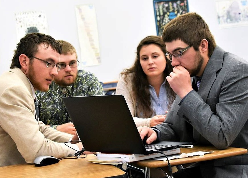 Cody Most, Riley Abbott, Erica Mowery and Nate Letcher of the NCTA Agribusiness Computer Team solve a problem at a national contest of agricultural college students. Abbott, Mowery and Letcher were third-year, double majors who graduated in May with academic honors. (Photo by Northeast Community College)