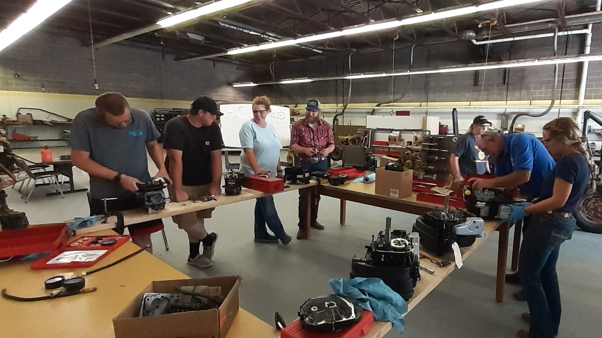 Small engines was one of the half-day sessions at the recent Ag Mechanics Boot Camp at the Nebraska College of Technical Agriculture in Curtis. Six agricultural educators attended the hands-on camp taught by Dan Stehlik, NCTA instructor (in blue shirt, second from right).  (Photo by Andela Taylor / NCTA)