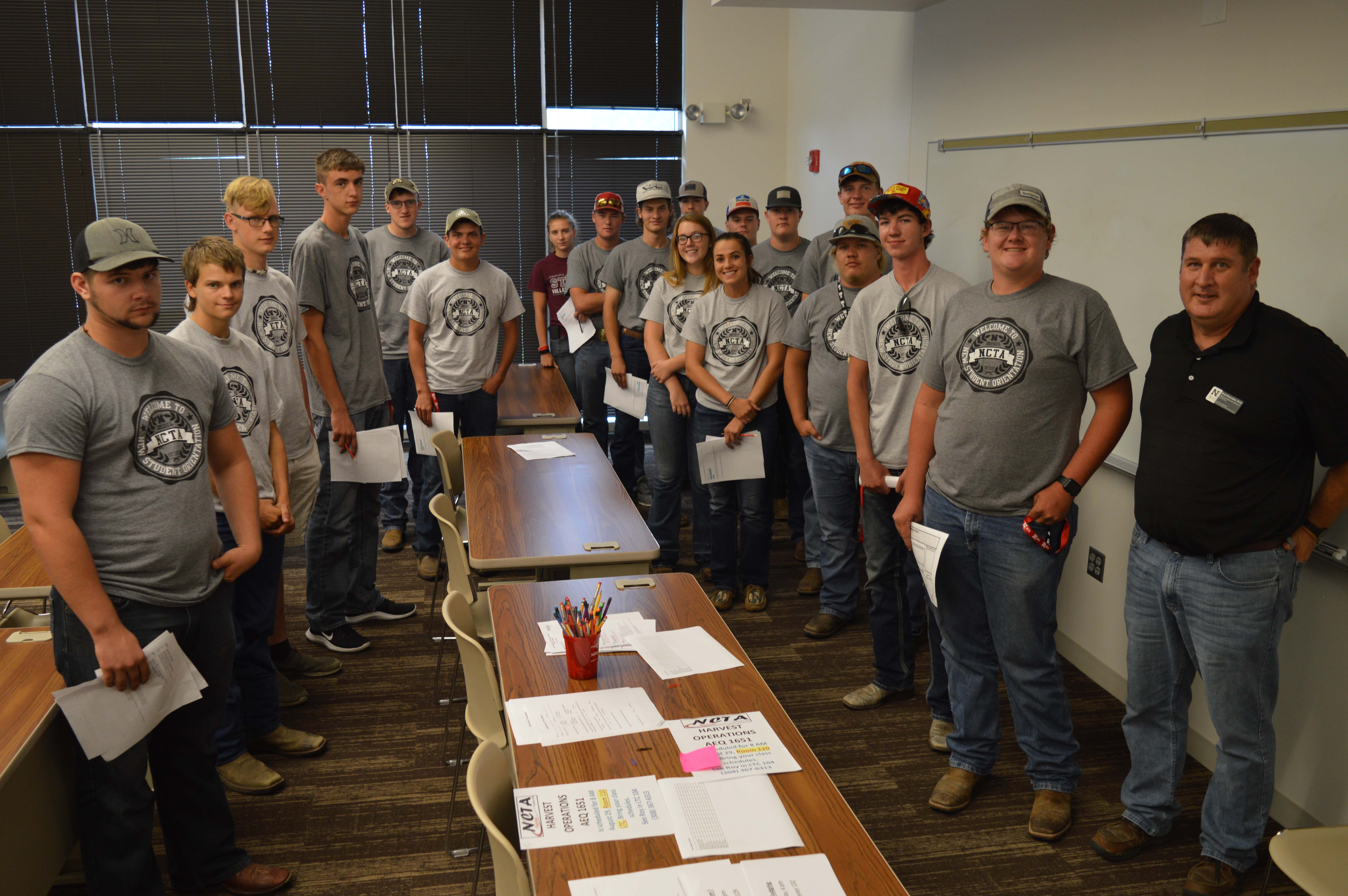 NCTA freshmen majoring in Diversified Agriculture (agronomy and livestock emphasis) gathered with Professor Brad Ramsdale, front right, at the start of fall semester. (Crawford / NCTA News)