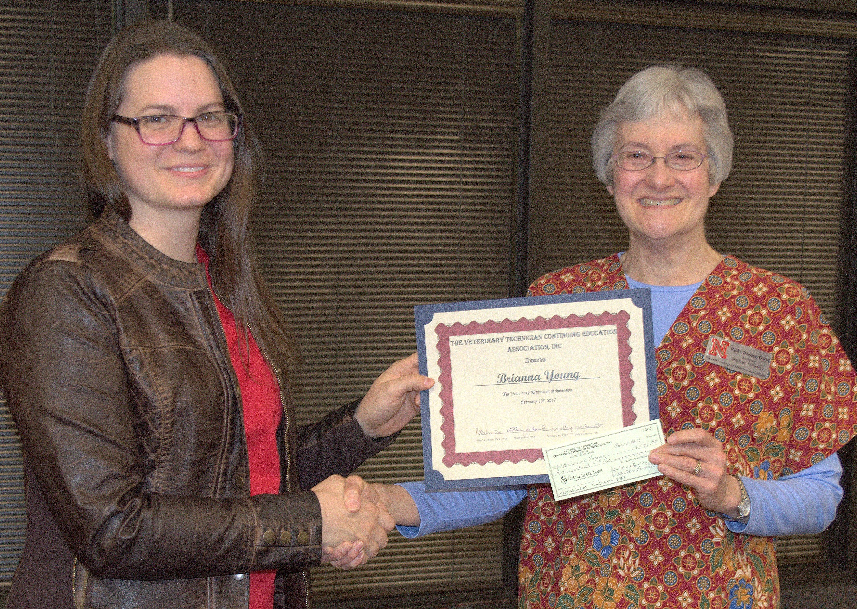 Brianna Young accepts her scholarship from NCTA Professor Ricky Sue Barnes, DVM. (Hauptman/NCTA News photo)