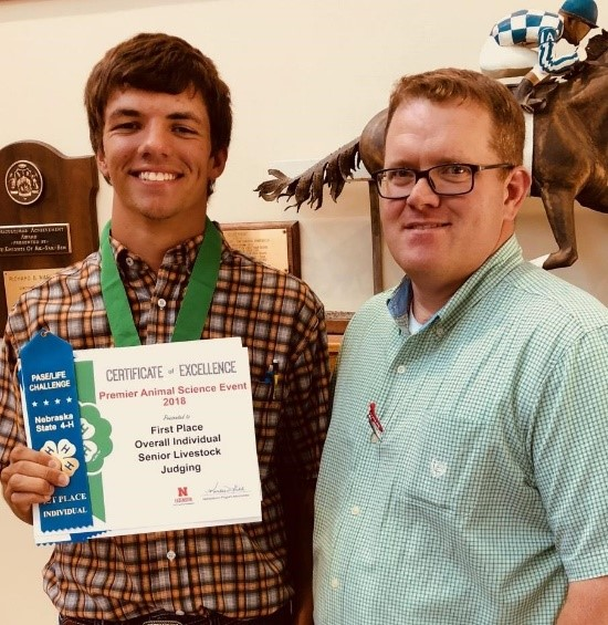 Camden Wilke of Columbus will begin his college career at NCTA in August. He visits with NCTA Animal Science professor and judging team coach Doug Smith after winning a livestock judging contest in Lincoln. Wilke is one of many recruits who visited NCTA this summer to register for classes. (NCTA photo)
