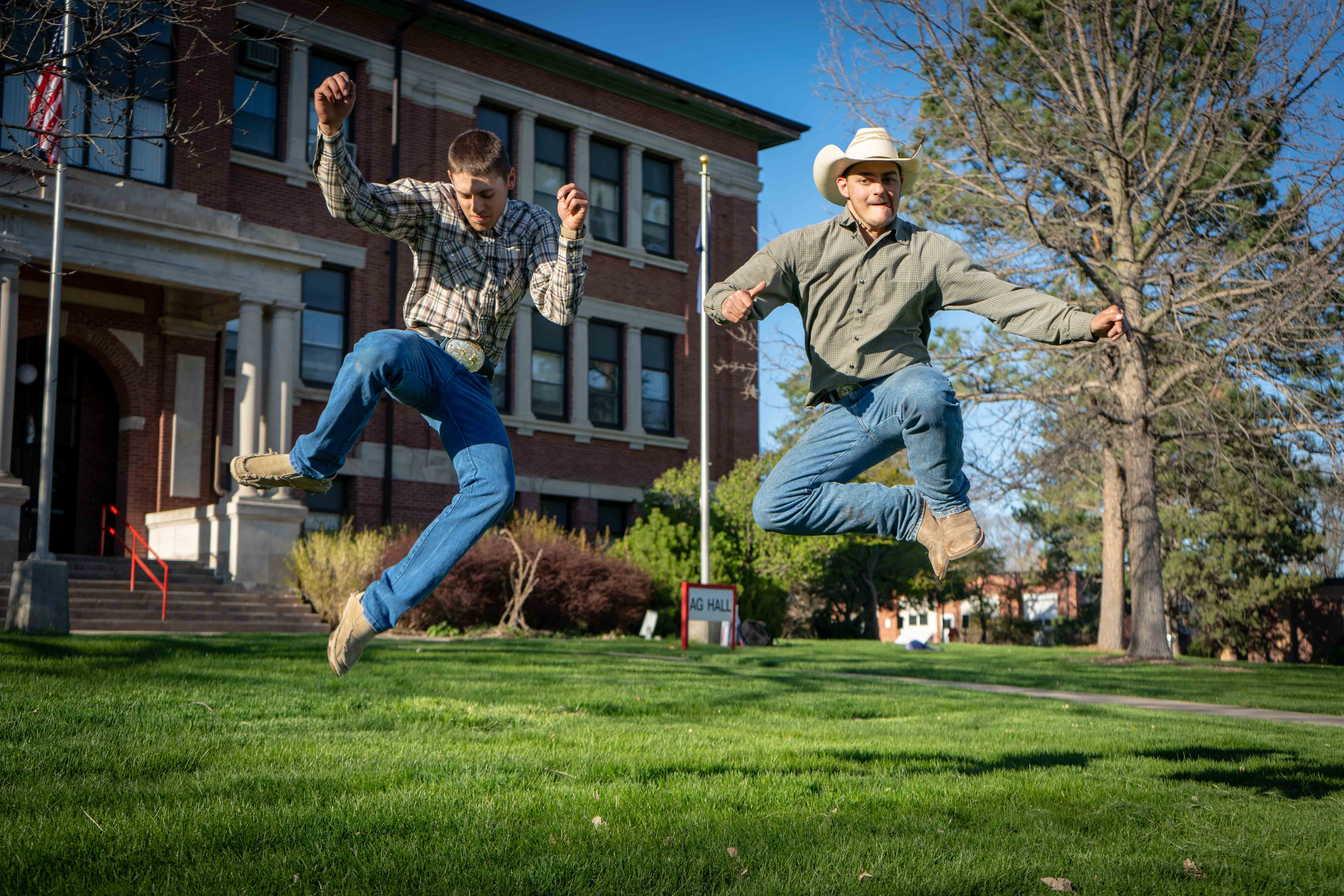 Cowboys demonstrate a bit of Aggie athleticism last spring. The two study animal science and have campus jobs with the NCTA farm in livestock management. (NCTA/Cannon Photo)