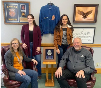Officers of NCTA Collegiate FFA (L-R) Taylor Hendrix of Colorado, Gillian Brinker of Alaska and Taylor Sayer of Nebraska, assemble in the office of NCTA Dean Larry Gossen. The Nebraska College of Technical Agriculture is observing National FFA Week Feb. 20-27. (Kenna Graves / NCTA Photo)