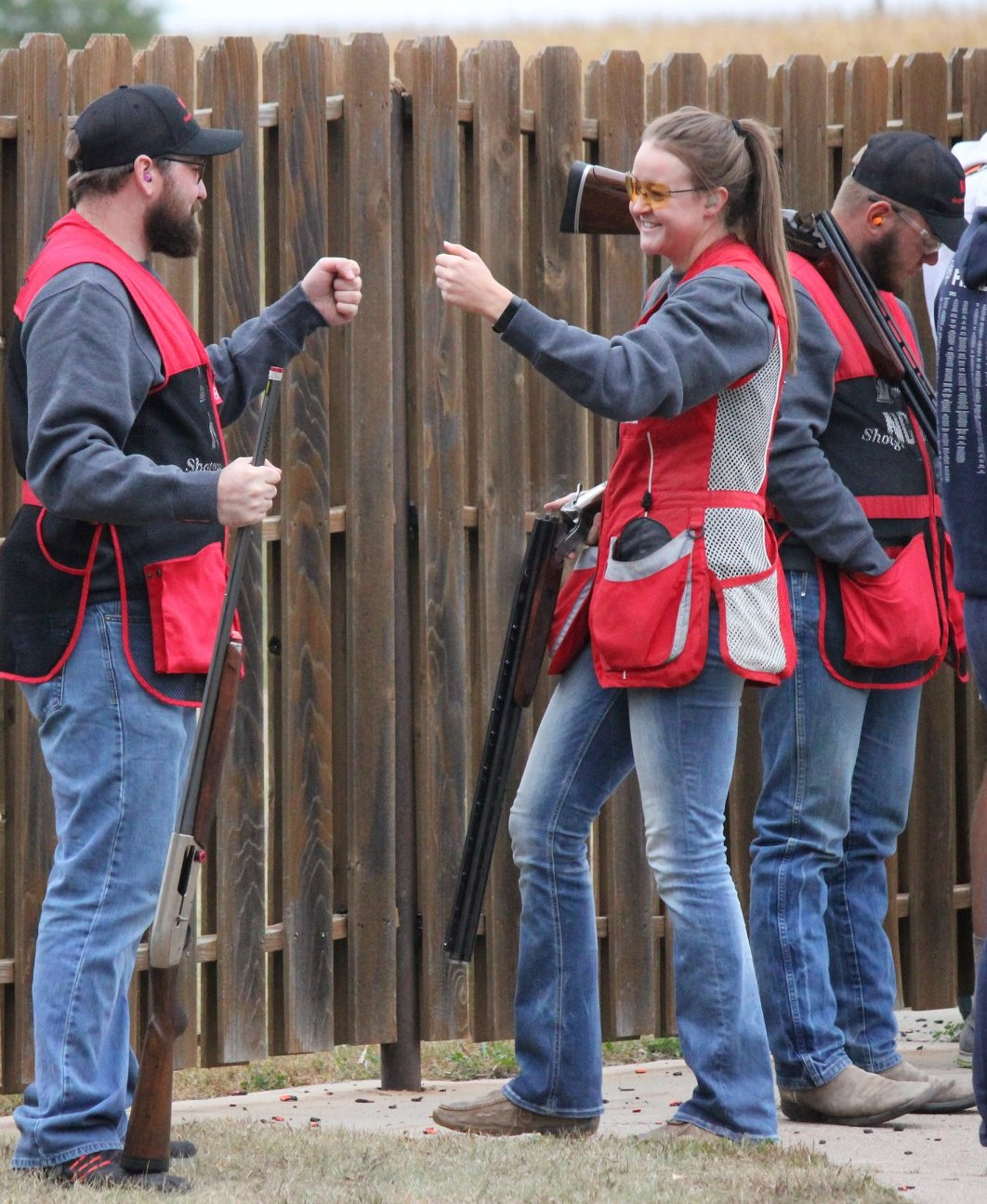 Top Aggie shooters Shawn Barger and Angela Crouse exchange a fist bump during a recent match. (Courtesy photo by Jody Crouse)