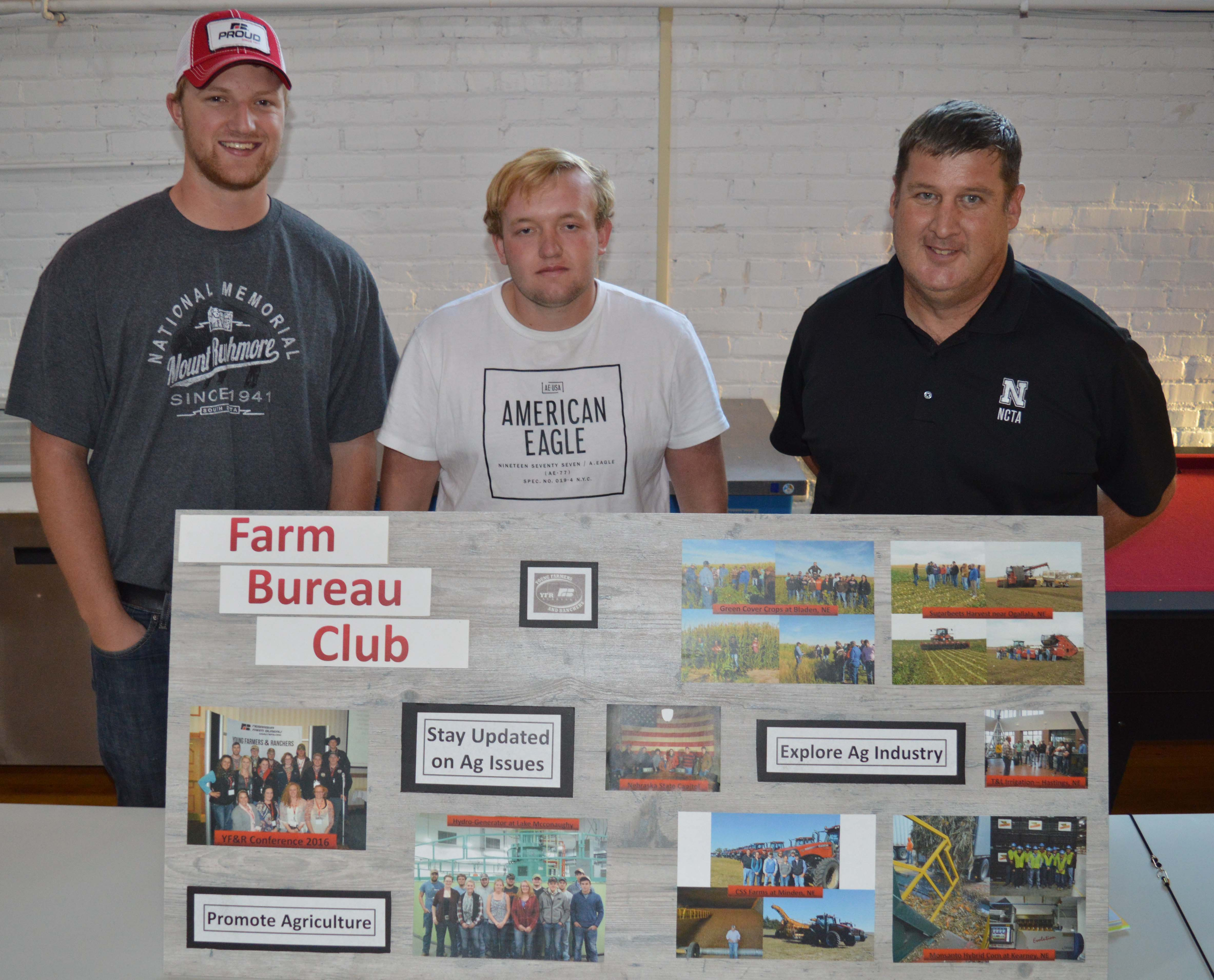 The NCTA college fair for clubs and organizations included the Collegiate Farm Bureau Club. (L-R) Clade Anderson of Otis, Kansas, Chase Callahan of Gothenburg and Professor Brad Ramsdale shared goals of the club to promote agriculture, stay updated on ag issues, and explore the ag industry. (Crawford/NCTA News photo)