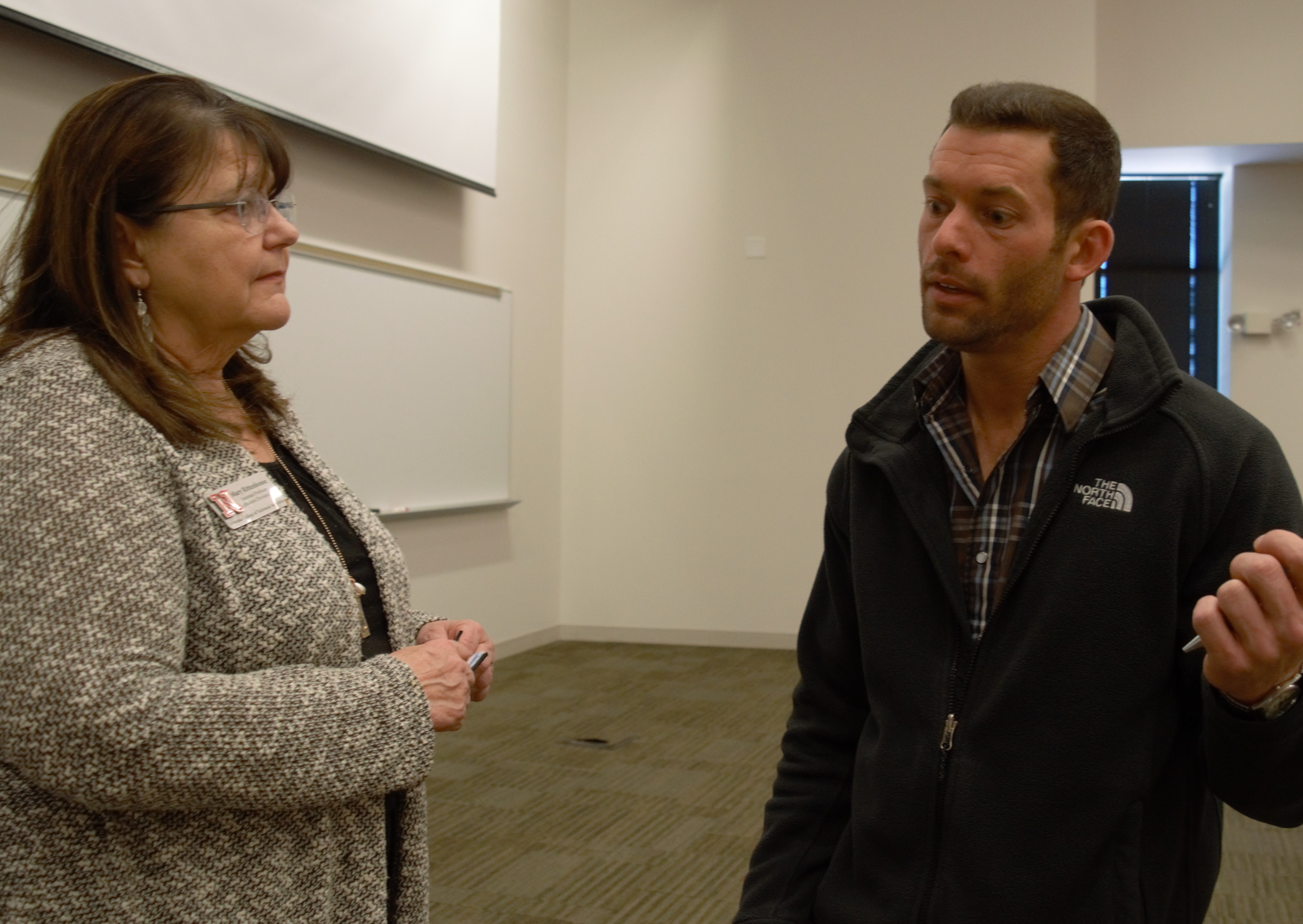 Wade Shipman discusses an agricultural finance seminar with Mary Rittenhouse, division chair of NCTA Agribusiness Management Systems. (Crawford, NCTA News)