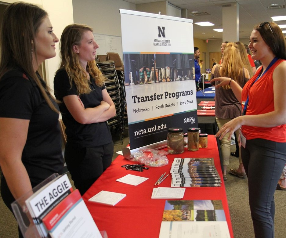 Recruiters discuss NCTA courses, teams and clubs with a prospective student.