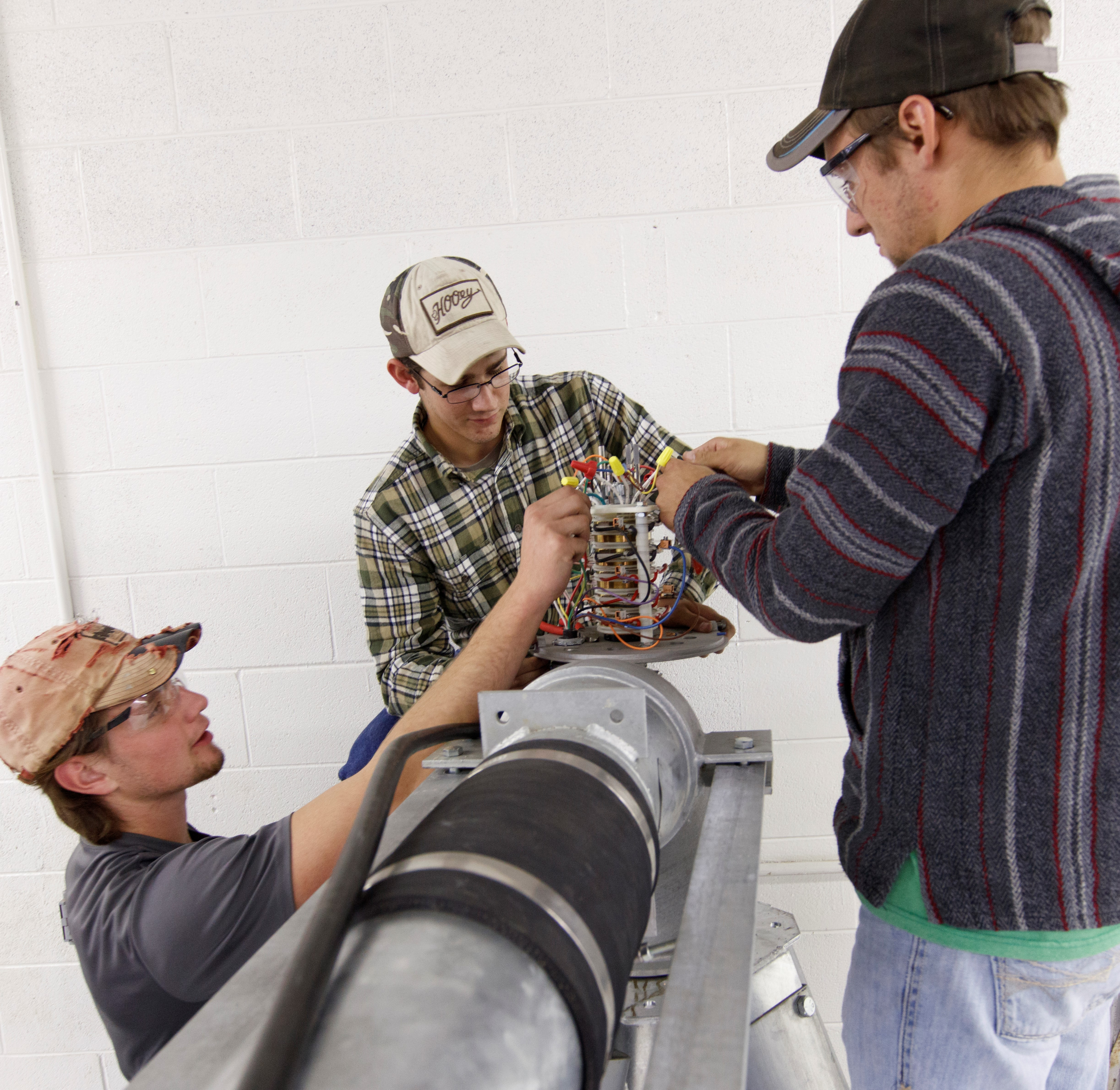 Students wire an electrical circuit on a center pivot irrigation system at the NCTA laboratory. (Craig Chandler / NCTA News)