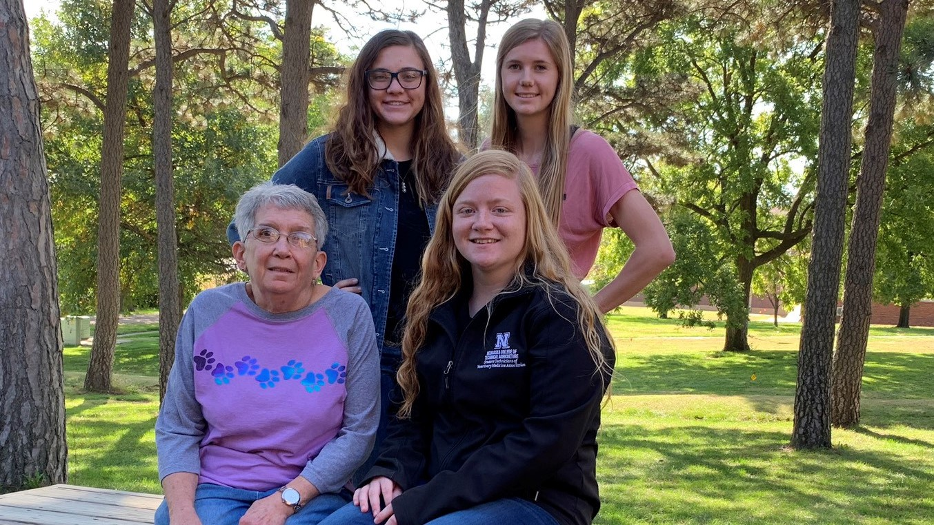 Recipients of the Glenn Jurgens Scholarship gathered last fall at the NCTA Veterinary Technology complex with Pam Jurgens of Curtis. Seated with Pam is Jenna Garver, joined by Anna Whyman, standing at left, and Tiffany Dickau, who will graduate in December. (Photo by Annie Basset / NCTA News)