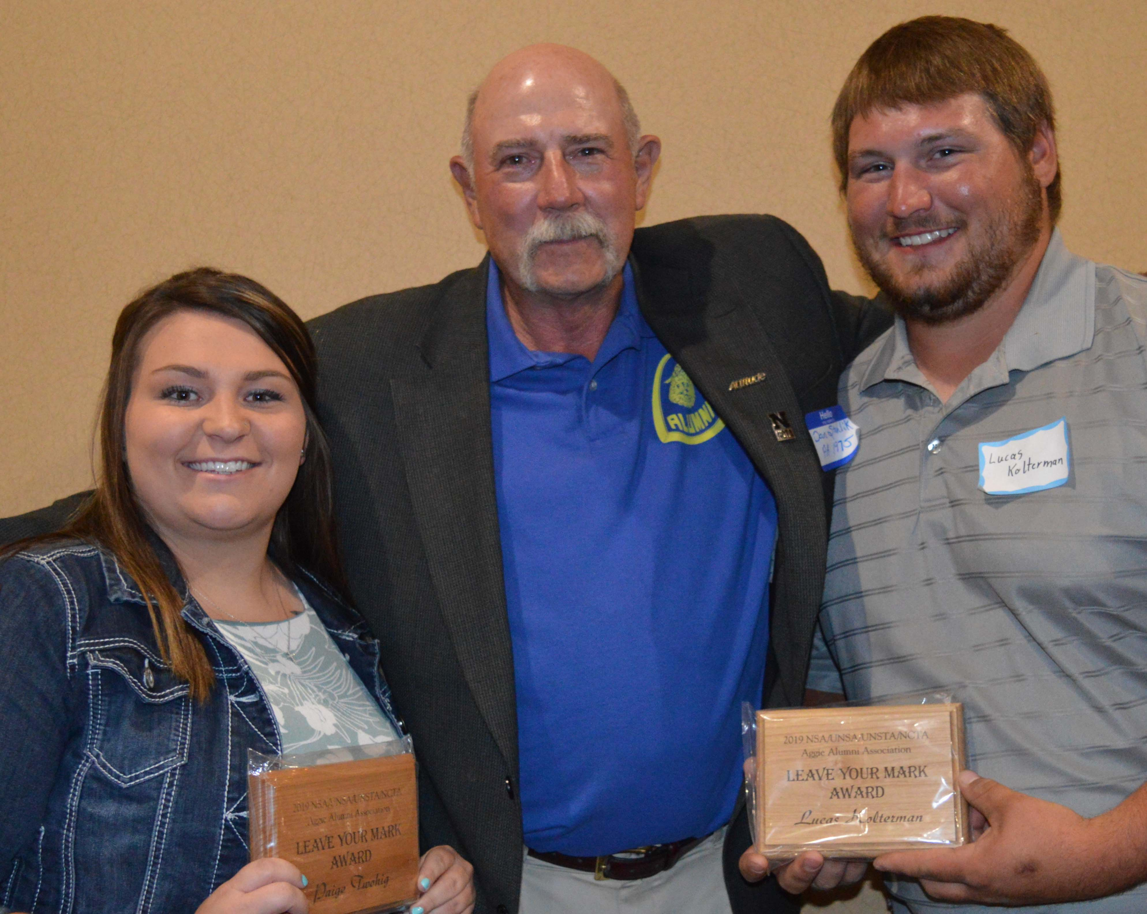 "Paige Twohig and Lucas Kolterman received ""Leave Your Mark"" awards from the Aggie Alumni Association, presented by NCTA alumnus and instructor Dan Stehlik. (NCTA Photo)"