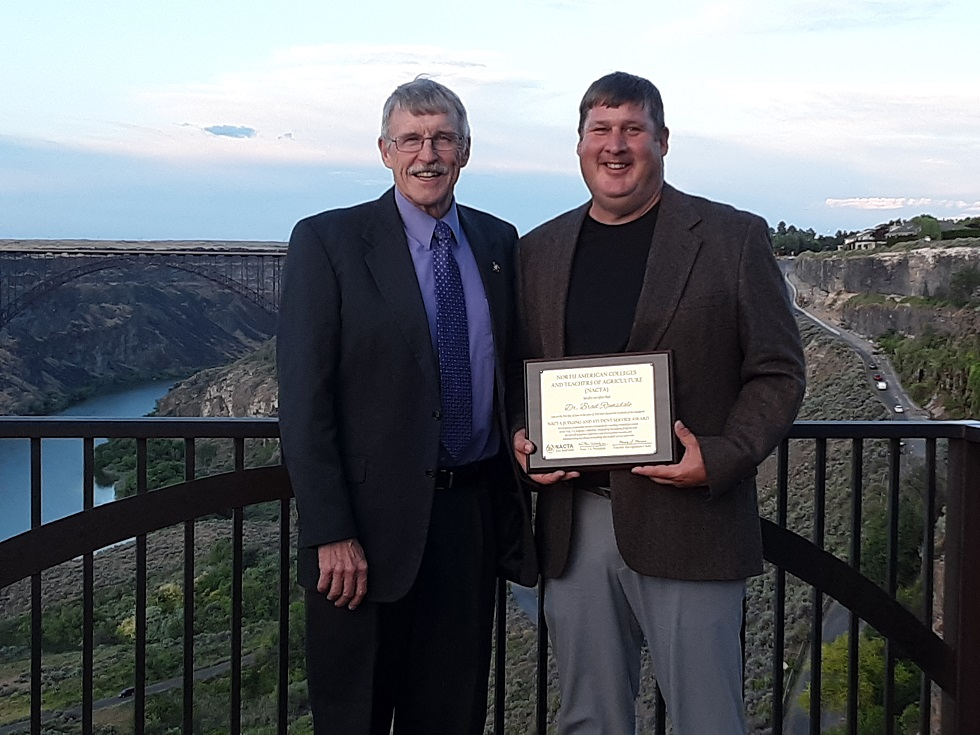 Dr. Brad Ramsdale (right) NCTA agronomy professor and crops team coach, received a national judging and student service award this summer at Twin Falls, Idaho, shown with Dr. Kevin Donnelly, who nominated him.