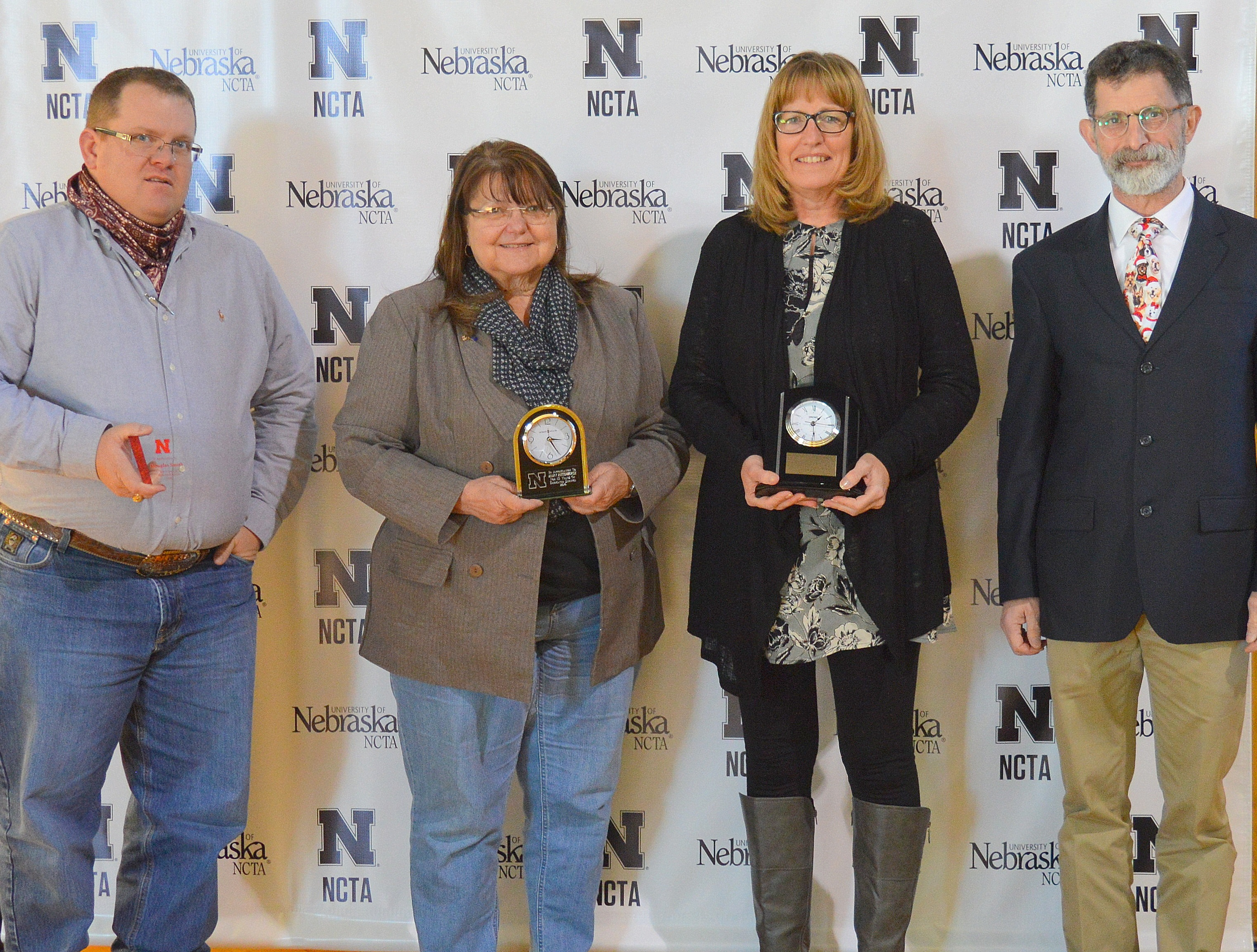 NCTA recognized a combined 40 years of service to the University of Nebraska by employees (from left) Dr. Doug Smith, 5 years; Mary Rittenhouse, 15 years; and Linda Cole, 20 years, with NCTA Dean Ron Rosati. (Hauptman/NCTA Photo)