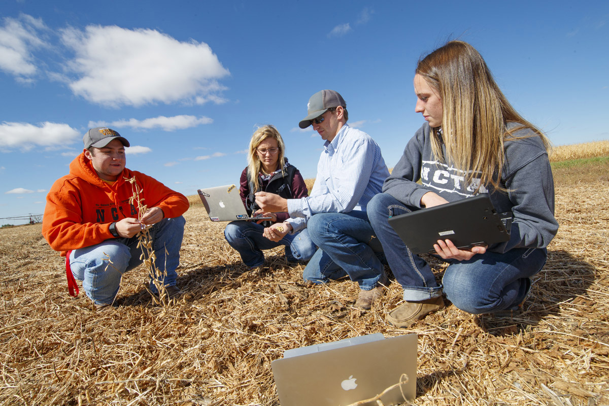 Students at the Nebraska College of Technical Agriculture in Curtis evaluate crop residue at the campus farm.Two of these NCTA graduates are pursuing a 4-year degree at the University of Nebraska-Lincoln. (Craig Chandler / NCTA photo)