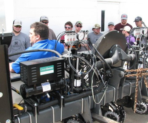 NCTA alumnus Anson Nielsen of Minden describes a new 6-row planter to NCTA students when he delivered it to campus in April. (NCTA Photo)