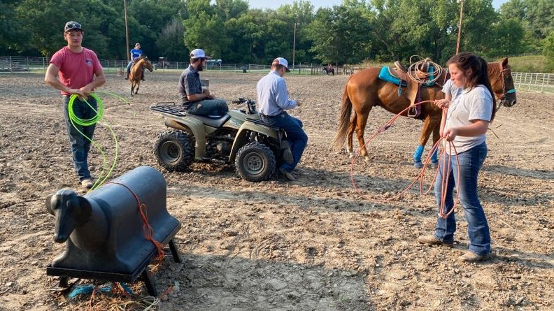 NCTA Aggie Rodeo athletes warm up with a roping dummy at Mill Park in Curtis before riding horseback. The Aggies are hosting a 10-week Round Robin Team Roping series each Tuesday at 6:30 p.m. (Photo by Annie Bassett / NCTA News)