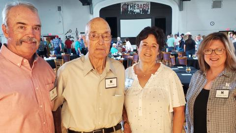 """The """"Curtis ag school"""" and beef cattle were among conversations at Aggie Alumni Day for Paul Coder, Class of '46, with his son Mike Coder, daughter Nancy Schmitz, and NCTA recruiting coordinator Andela Taylor. (M. Crawford photo / NCTA News)"""