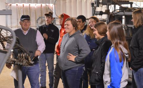 North Platte students observe Dr. Doug Smith demonstrate equipment for processing cattle during health checkups at the NCTA Red Barn. Students visited campus last year to see animal science in action. (NCTA photo)