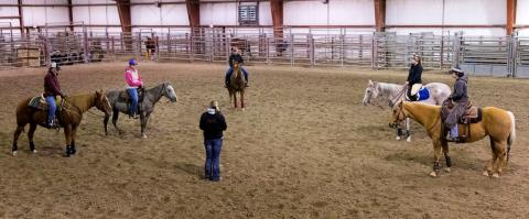 NCTA Ranch Horse team members discuss upcoming competitions with Coach Joanna Hergenreder. (NCTA/Craig Chandler Photo)