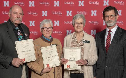 Dan Stehlik, Judy Bowmaster-Cole and Ricky Sue Barnes Wach, DVM, were recognized March 1 by the UNL Parent Association. NCTA Dean Ron Rosati applauds their dedication to students. (UNL University Communication)
