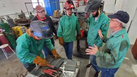 Certified Welding Inspector Chuck Hatzenbuehler (far right) describes the national certification criteria to (from left) Dalton Olsen, instructor Dan Stehlik, Clancey Smith and Sam Schukei. (Photo by Crawford / NCTA News)
