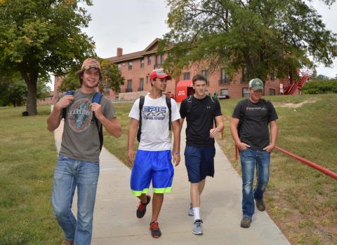 NCTA students walk to economics class at Ag Hall. (Crawford/NCTA News)