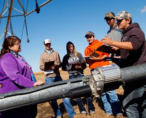 Mary Rittenhouse, Agri Business Management professor, visits with students about costs of production at the NCTA Farm. For high school students in dual credit, she teaches two online classes, Introduction to Ag Economics and Principles of Microeconomics. (Chandler/NCTA Photo)
