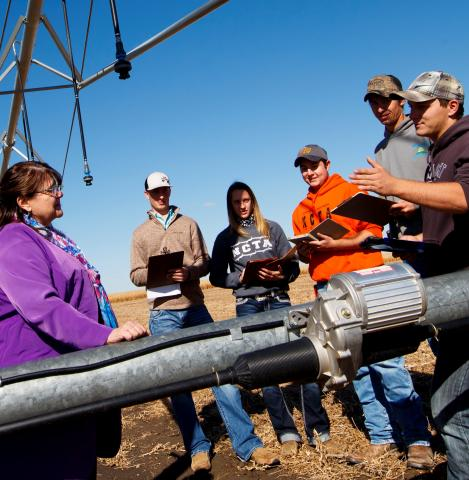 Agribusiness management students with Mary Rittenhouse on a visit to the NCTA Field Laboratory near campus. (Craig Chandler / University Communication photo)