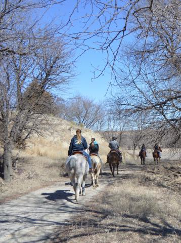 Equine students ride a trail down to Aggieland north of the NCTA campus. (Crawford/NCTA News photo)