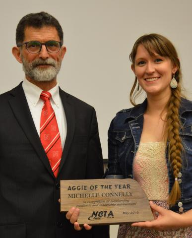 NCTA Dean Ron Rosati presents the 2016 Aggie of the Year award to Michelle Connelly, who is a certified veterinary technician with a private practice in Kearney. (Crawford/NCTA Photo)