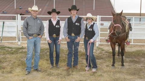 NCTA Rodeo Coach Jaden Clark, at left, joins Celeste Tanguay, Nathan Burnett and Ellie Stohlmann prior to the Thursday night rodeo in North Platte. (George Hipple photo for NCTA)