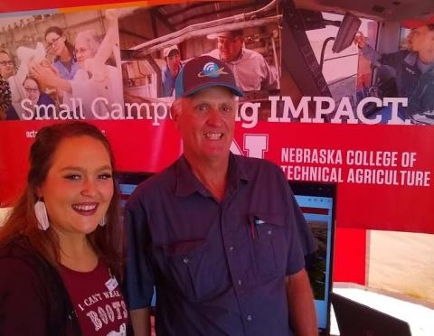 NCTA ag education major Audrey Heinz of Eaton, Colorado, visits with NCTA alumnus Conrad Nelson, who farms near Wallace about student programs. (M.Crawford/NCTA News photo)