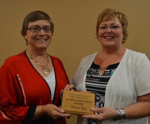 Barbara Berg, left, receives the 2017 Aggie Alumni Achievement Award from Kim Mortensen. (Crawford/NCTA News photo)