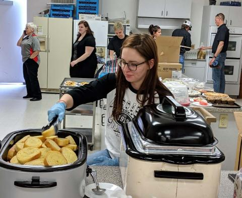 NCTA student Sadie Christensen of Arnold serves food at the NCTA pasta benefit in Curtis on March 26.  (Meredith Cable / NCTA photo)