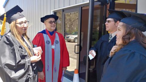 Three graduates from the Class of 2019 at the Nebraska College of Technical Agriculture chat with University of Nebraska Vice President Mike Boehm prior to commencement in Curtis. In 2020, graduation was a virtual event. (Crawford / NCTA file photo)