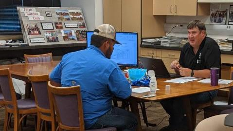 Dr. Brad Ramsdale, NCTA agronomy professor, meets with Pedro Bernal from Comanche, Texas, at New Student Enrollment last month. NCTA Dean Larry Gossen invites prospective students to attend the next NSE Day on Tuesday, July 7. (NCTA photo)
