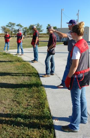 The Aggie Shooters receive trap shooting tips from Britt Dalton, who was helping the trap squad at a recent workout. (Mary Crawford/NCTA News)