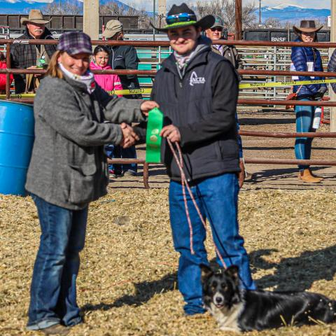 "NCTA ""Aggie of the Year"" CJ Monheiser of Hershey, Nebraska, at right, competed at the National Western Stock Dog Trials at Denver in January, with his dog, Addie. (NCTA / XP Ranch Photography)"