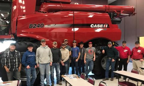 NCTA Aggie students saw manufacturing of an axial-flow combine last month. (L-R) Kolton Begay, Towaoc, Colo.; Jarrod Tuttle, Eltopia, Washington; Chase Stanley, Shickley; Dalton Olson, Kenesaw; Blake McCormick, Lewellen; Sam Schukci, Kenesaw; Clancey Smith, Amherst; Tanner Dickau, Bassett; Troyle Burris, Hoxie, Kansas; David Jelken, Juniata; and two guides from CNH. (Stehlik/NCTA Photo)