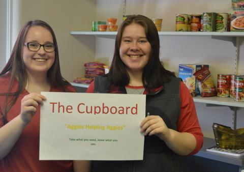 """Haley Farr, left, and Christine Land say """"Aggies Helping Aggies"""" at The Cupboard has been a popular Agribusiness Club service project on campus this year. (Brent Thomas/NCTA photo)"""