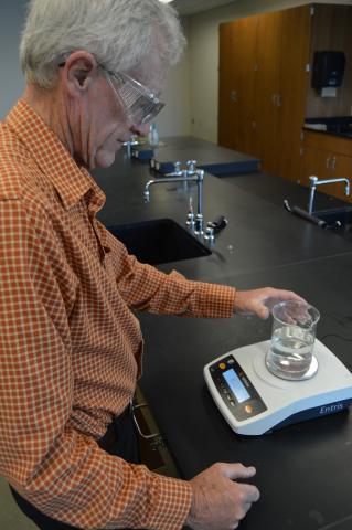 Dan Widick, biology instructor, in the NCTA chemistry lab. (Crawford/NCTA photo)