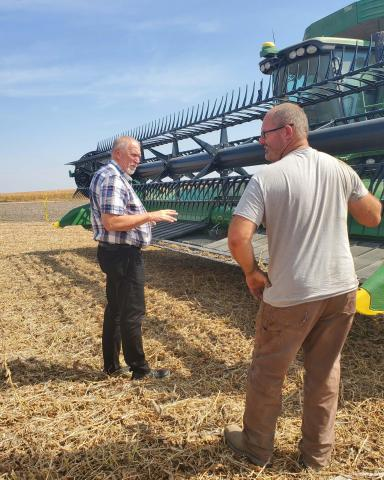 NCTA Dean Larry Gossen checks out harvest machinery with Kirk McConville of Indianola. (Photo by J. McConville / NCTA)