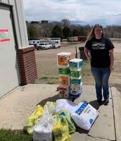 Emily Giese of Papillion, a diversified agriculture student at the Nebraska College of Technical Agriculture in Curtis, and member of Women in Agriculture, prepares to load disaster donations Friday morning. WIA faculty advisor Meredith Cable is delivering supplies on behalf of the NCTA WIA Disaster Relief project. Many of these supplies were donated by a church in Gothenburg. (Photo by Jocelyn Kennicutt / NCTA News)