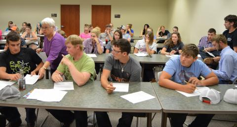 Jo Bek, instructor, assists NCTA students in equine safety certification on opening day of classes. (NCTA News Service photo)