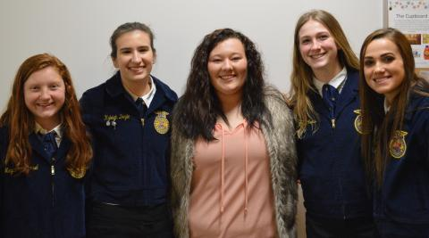 NCTA agricultural education major Kayla Mues of Cambridge visits with high school friends, Megan and Kyleigh, to her left, with Rylee and Taylor, to her right during a District 11 FFA contest in Curtis. Kayla is among NCTA Aggies assisting at FFA convention and contests in Lincoln this week. (Jocelyn Kennicutt / NCTA News photo)
