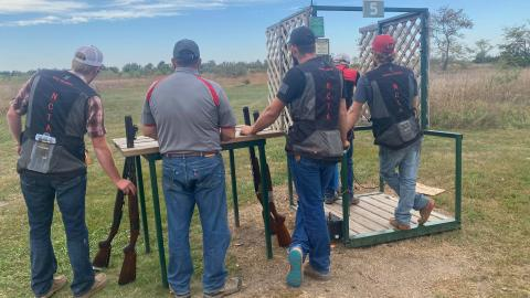 Aggie Shotgun Sports team members from the Nebraska College of Technical Agriculture are identified by NCTA vests. They shot last weekend in a match at Heartland Shooting Park near Grand Island. Coach Alan Taylor is second from left. (Photo by Kaden Bryant / NCTA)