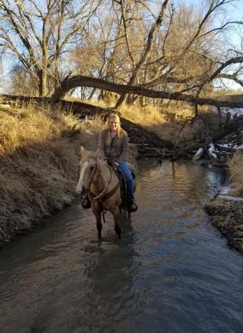 Huntra Christensen rides her horse, Sadie, at the NCTA Aggieland creek and pasture north of campus earlier this winter. (Photo by R. Porter/NCTA)