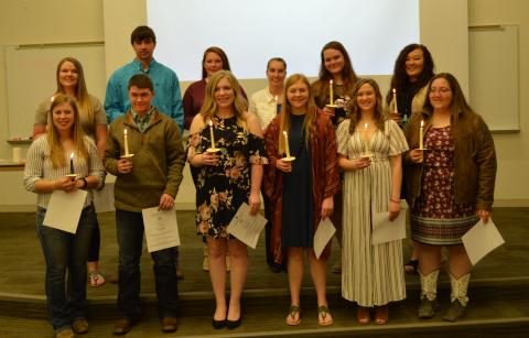 Inductees present for initiation to Phi Theta Kappa at the Nebraska College of Technical Agriculture, Curtis included front, from left: Kelly Gordon, Luke Peters, Jocelyn Kennicutt, Emily Riley, Aurora Urwiler and Alexis Penna. Back row, Morgan Curran, Dean Fleer, Kaylee Hostler, Catherine Ljunggren, Amanda Schmidt, and Kayla Mues. (E. Griffiths / NCTA Photo)