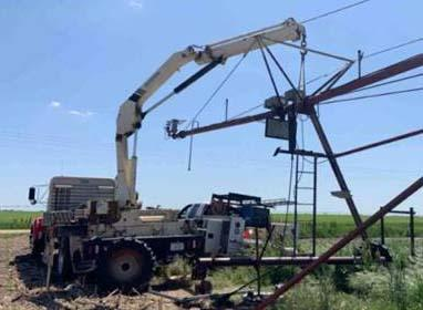 NCTA irrigation technology and agribusiness management major Jarrod Tuttle repairs a tower on an irrigation center pivot. (Courtesy photo)